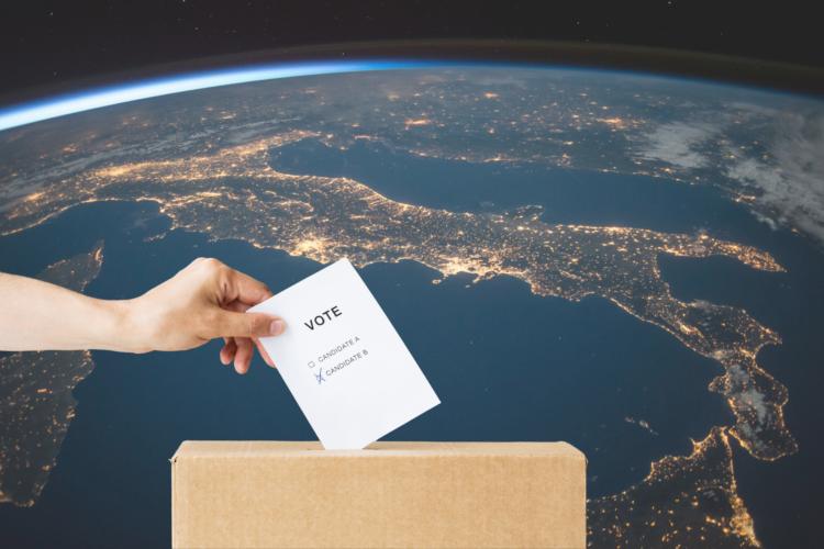 Wahlurne vor Planet Erde
